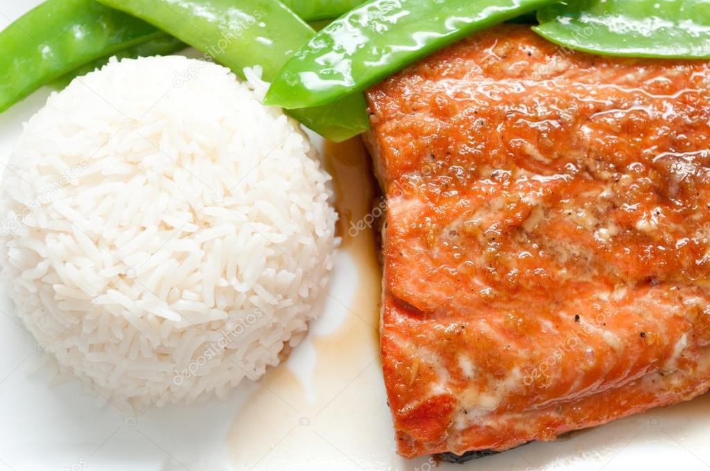 Salmon fillet with white rice, snow peas and a maple soy glaze