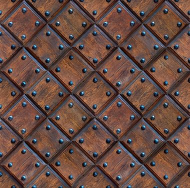 seamless wooden panel door texture with nails