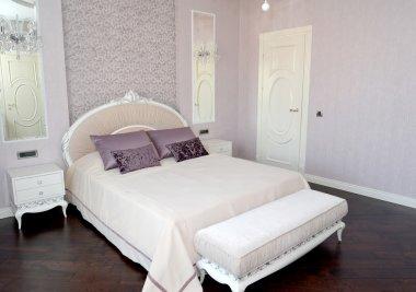 Bedroom interior in light tones. Modern classics with rococo ele