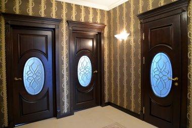 Wooden brown doors in a hall
