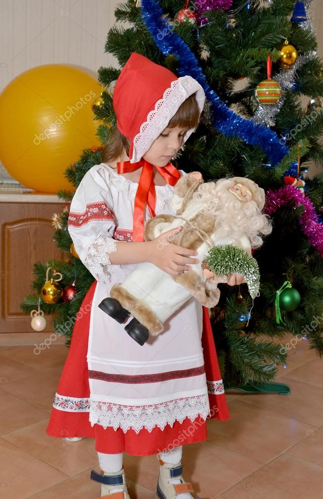 The little girl in a suit of the Little Red Riding Hood with toy