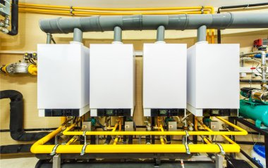 a row of four powerful domestic gas boilers