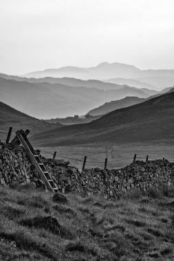 View along misty valley towards Snowdonia mountains  black and w