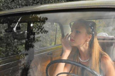 Pretty woman in old car