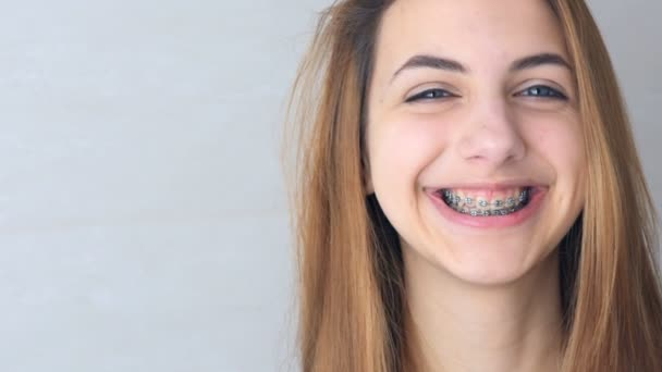Beautiful smiling girl with retainer for teeth .