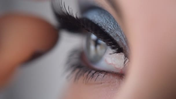 Beauty woman eye makeup. False eyelashes.