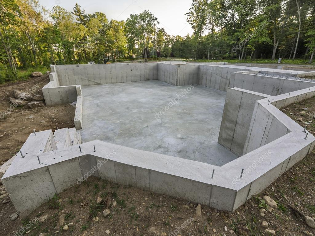 Concrete foundation for a new house construction stock for Concrete home construction