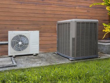 Two air conditioning heat pumps