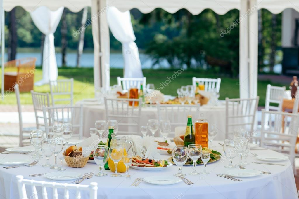 Preparation for a buffet catering service. Restaurant table with food at event u2014 Photo by alezandro & Outdoor Table Setting u2014 Stock Photo © alezandro #113408224