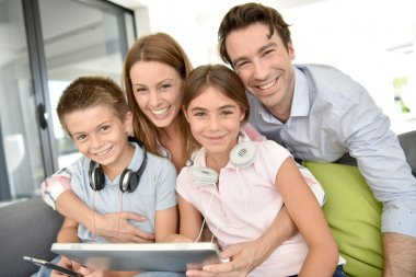 Family playing with tablet