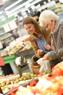 Elderly woman with young woman shopping