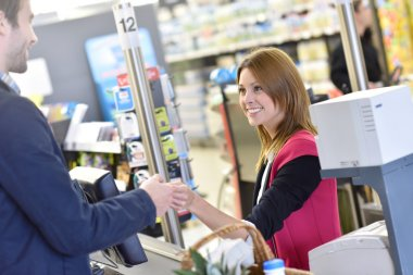 cashier with customer paying