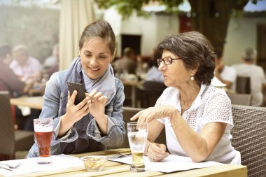 woman and home carer  using smartphone