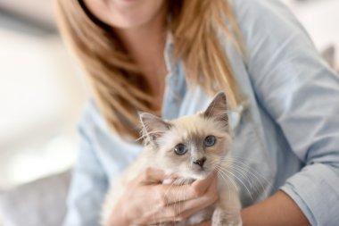 Woman with little kitten