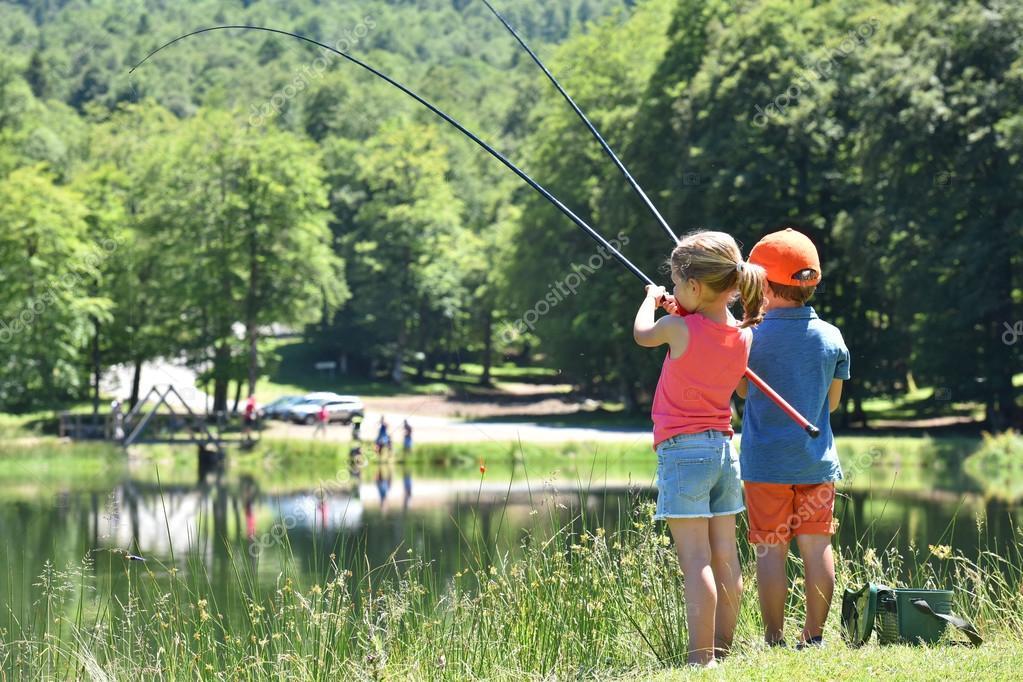 Kids fishing by mountain lake