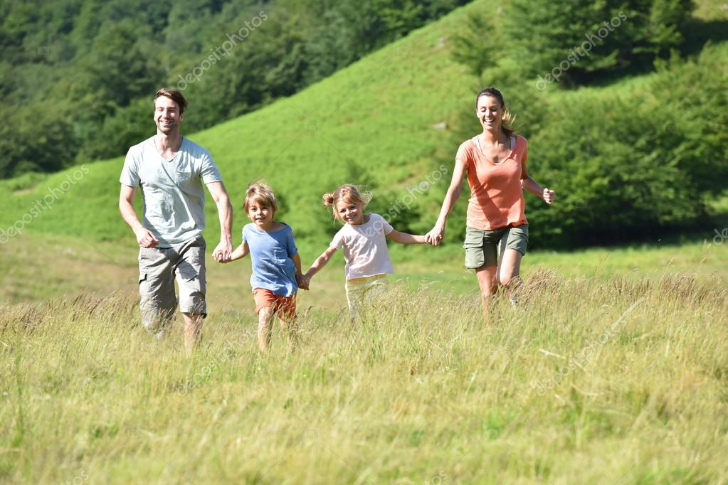 Family  running down the hill