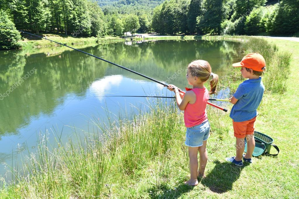 Kids fishing by mountain lake