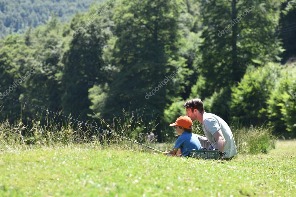 Dad with little boy fishing