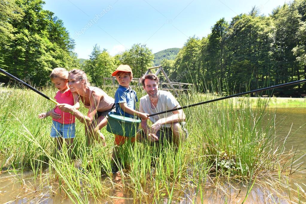 Family fishing in lake