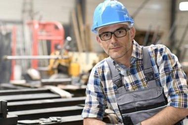 metalworker in workshop working