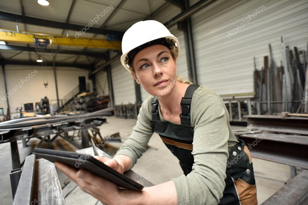 woman in factory using tablet