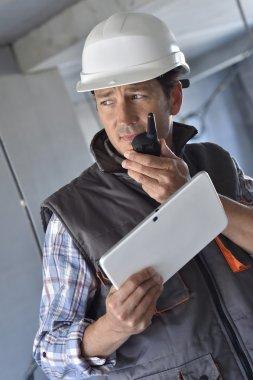 Entrepreneur using walkie talkie