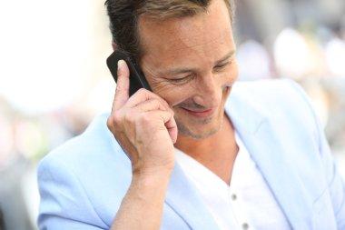 Mature man talking on phone