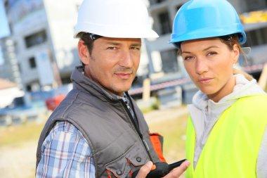 Construction partners on building site