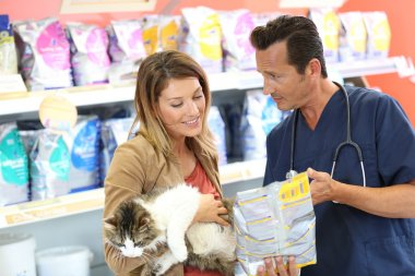 Veterinarian showing pet food to client