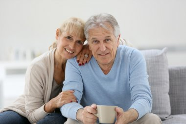 Senior couple sitting on couch