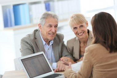 Couple meeting financial adviser