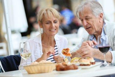 Couple eating Spanish fingerfood