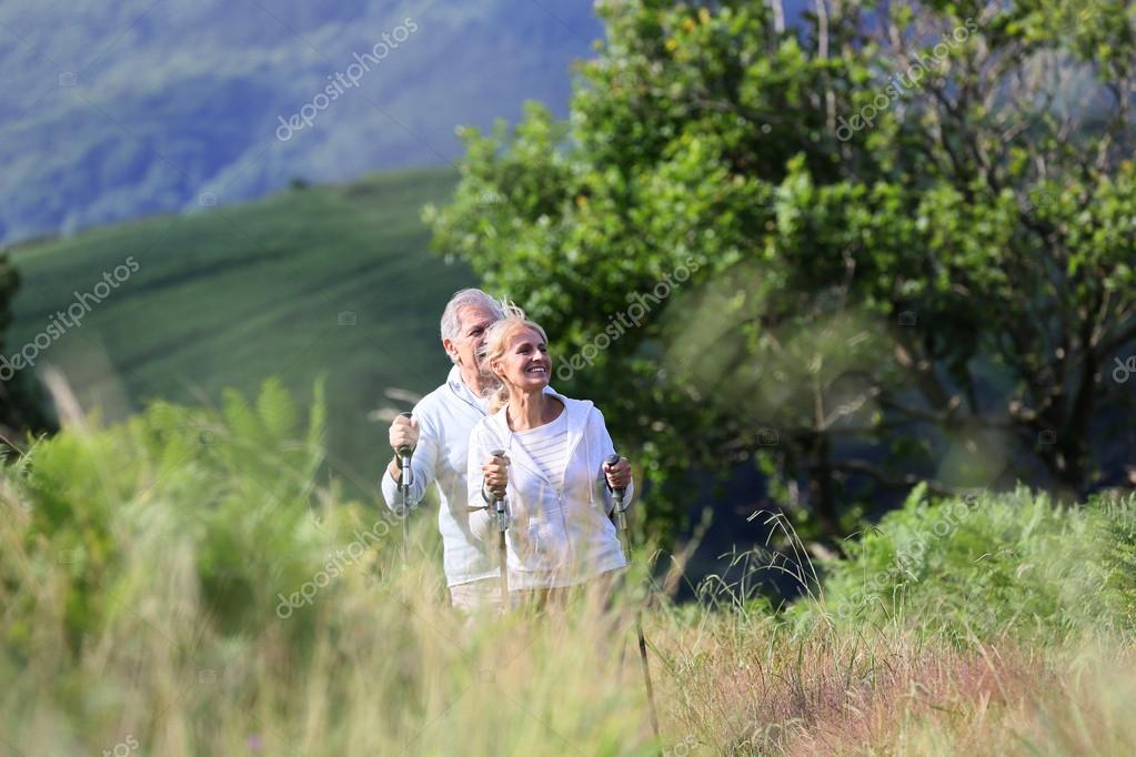 Senior people hiking