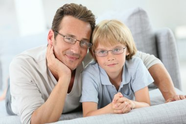 Daddy and son wearing eyeglasses
