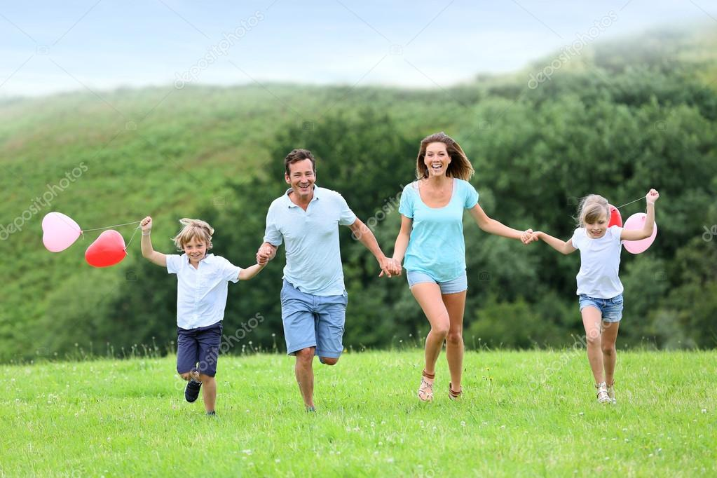 Family running in countryside