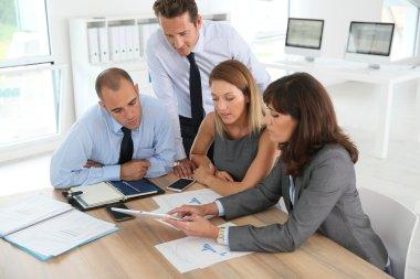 Business people meeting wih tablet