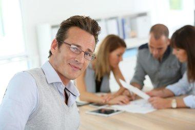 Businessman attending work meeting