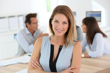 Woman attending business meeting