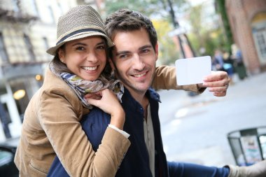Couple showing New York City pass