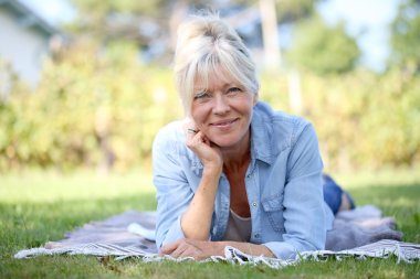 Woman laying in garden and relaxing