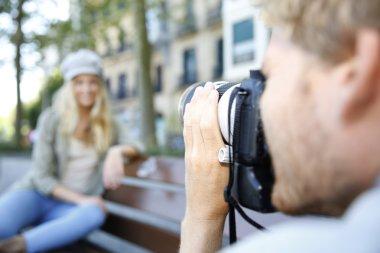 Photographer photographing fashion model