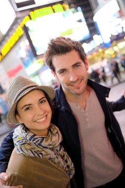 Couple standing in Time Square