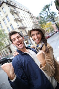 Couple shouting and showing happiness