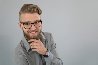 Trendy man with beard and glasses