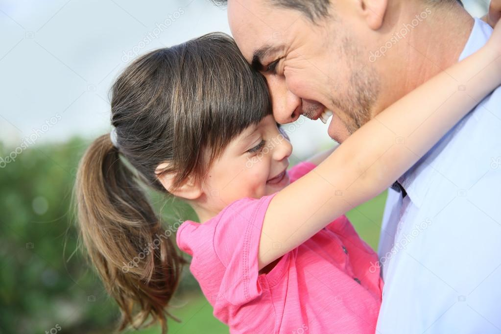 Little girl hugging her daddy