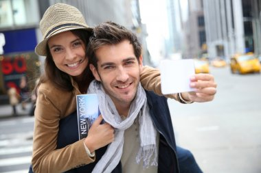 Tourists showing New York pass