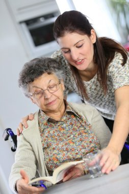 Elderly woman with home carer