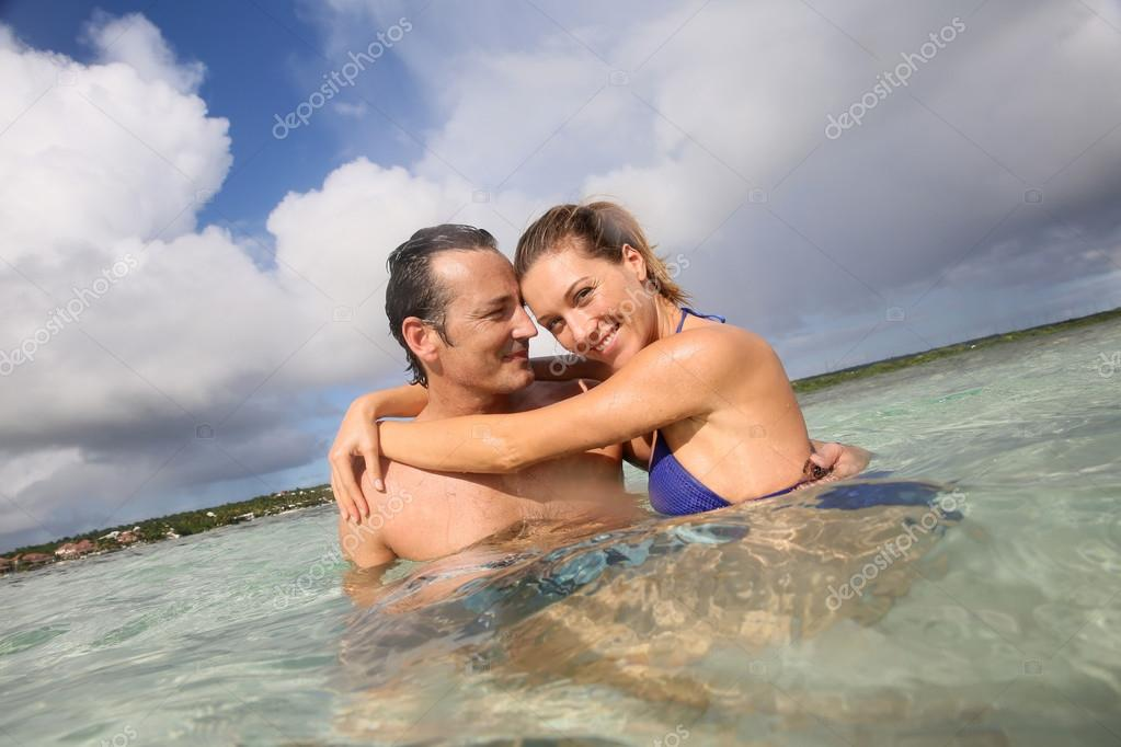 Couple embracing in sea