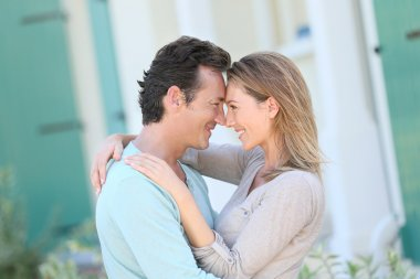 Middle-aged couple embracing