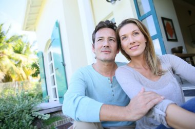 Couple sitting on house front door